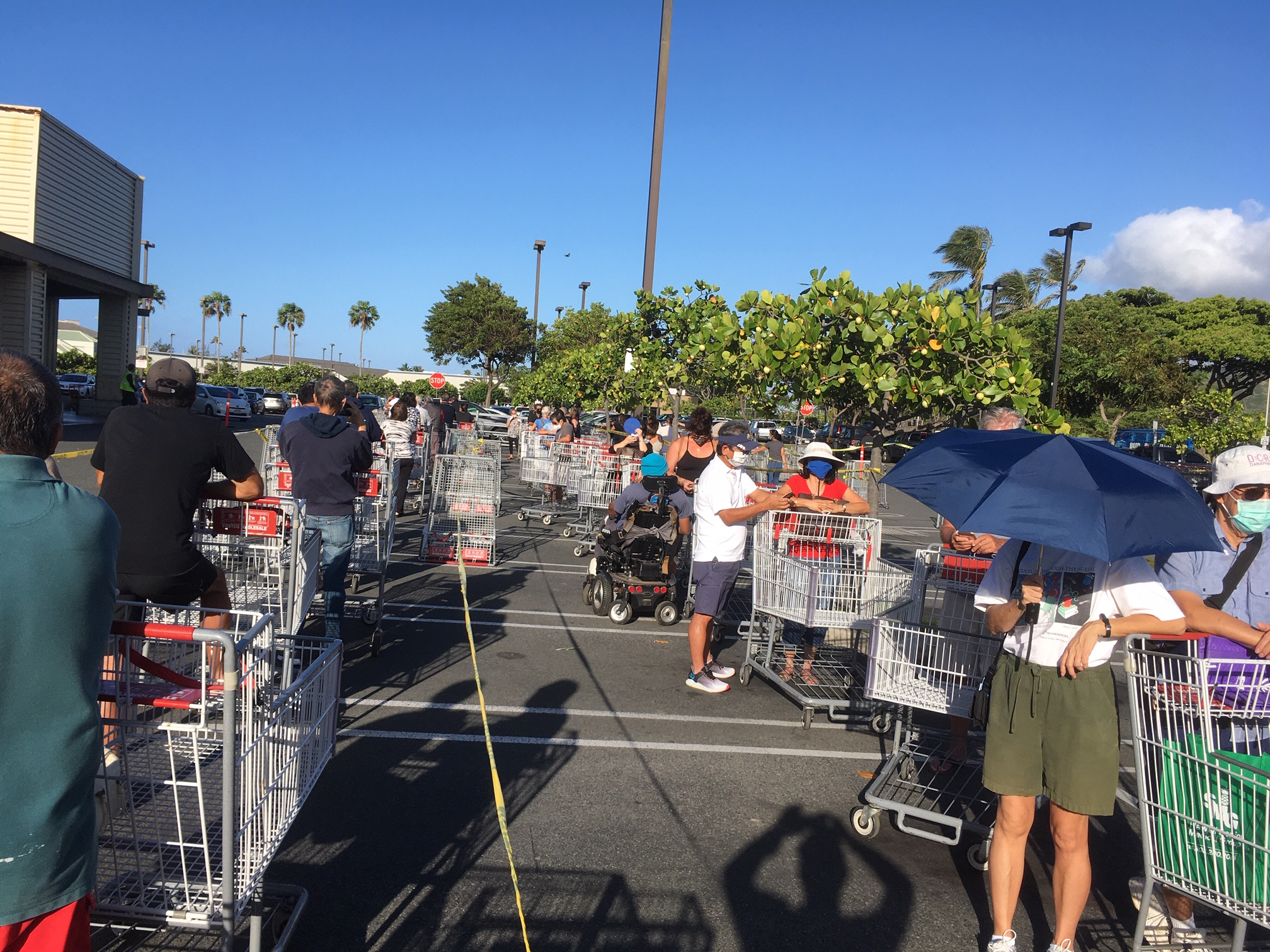 Shoppers in line outside of Costco